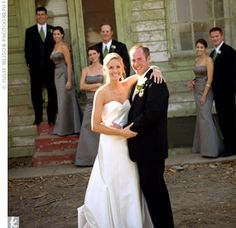 The bridesmaids wore floor-length, charcoal gray dresses to coordinate with the gray and green wedding colors.