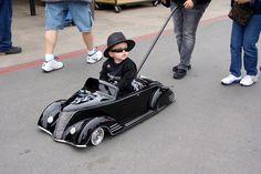 Little man in black.