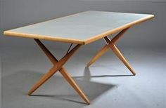Hans J. Wegner. Cross-legged, solid oak table. Top with linoleum inlay. Model PP85, produced by PP Møbler. Designed in 1955. H. 71. L. 180 W. 85 cm. Traces of wear, superficial marks. Minor marks from screws on surface. Unoriginal screws.
