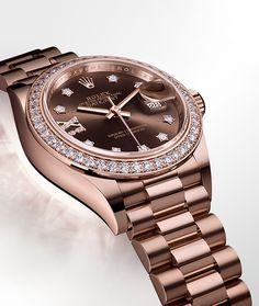 Rolex Lady-Datejust 28 in 18ct Everose gold with a chocolate dial, diamond-set bezel and President bracelet.
