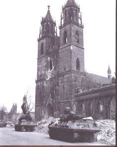 Column of 823rd Tank Destroyer Battalion M-10 Wolverines roll through downtown Magdeburg, Germany, April, 1945.