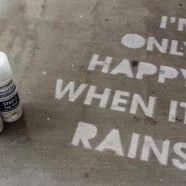 Use never wet spray can...that part of the pavement stays dry. So you only see it when it rains.