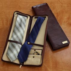 """Sweet tie case... They also have a compartment for jimmy hats cause you'll always be """"doing it"""" if you rock this look."""
