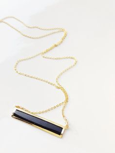 Simple and great for everyday wear this 14k gold filled dainty chain is combined with a black Agate bar. Wear alone or layered it with more
