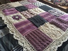 20 different crochet squares, done in Aran wool