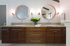 Designed by Jamie House Design. Photographed by Laurie Perez. #houston #interiordesign #texas #midcenturymodern #layered #remodel #moderndesign #jhd #intuitivedesign #masterbath #floatingvanity #roundmirrors