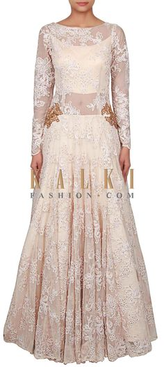 Buy Online from the link below. We ship worldwide (Free Shipping over US$100) http://www.kalkifashion.com/cream-gown-adorn-in-thread-and-zardosi-embroidery-only-on-kalki.html