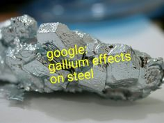 Crystals of gallium. The chemical element gallium is a rare, soft silvery metallic poor metal. It occurs in trace amounts in bauxite and zinc ores. Gallium is notable for its stunning silvery color and its solid metal fractures conchoidally like glass. Types Of Crystals, Large Crystals, Crystals Minerals, Rocks And Minerals, Signo Virgo, Melting Metal, Melting Point, Periodic Table Of The Elements, Element Symbols