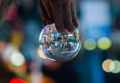 A shot of Times Square in NYC as seen through a crystal ball.
