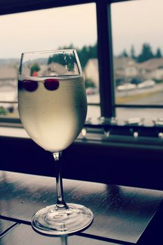 Prosecco , white cranberry with frozen cranberries to keep it cold