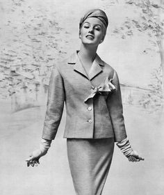 Barbara Cailleux in green tweed suit, jacket knotted on the side below the lapel, turban style hat, by Jacques Fath. Photo by Georges Saad, 1950s.