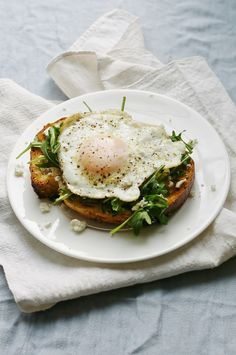Fried egg on toast with herb oil