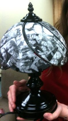 This is a picture lamp... I have been making these for years.  I got the idea from my friend Joy, who made one for me in high school, and I have been making them since. Buy a $20 touch lamp from Lowe's, print out about 45 pictures black and white on regular paper, paint the lamp black with spray paint, don't paint the glass pieces, use matte and shinny Mod Podge... use the matte kind to glue the pictures down with on the glass pieces and use the gloss kind to gloss over it at the end.  As…