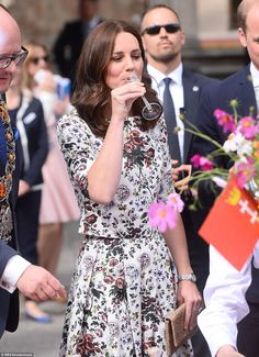 Showing off her style: The Duchess looked radiant in a white floral two-piece from Erdem as she greeted crowds as the music by Capella Gedanesis, a world renowned ensemble, played in the background