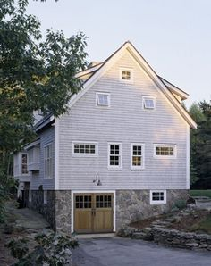 Nice shape with dormers and like the garage underneath on an incline