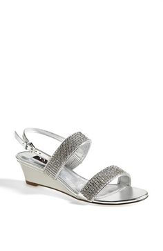 Free shipping and returns on Nina 'Felixa' Sandal at Nordstrom.com. A gleaming array of pyramid studs lends armored luster to a mod, strappy sandal with clean lines and a low wedge heel.