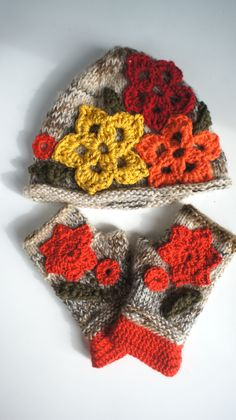 Hat & mitts decorated with crocheted flowers. 100% HANDMADE work using high quality yarn - alpaca, mohair, wool -polyacryl. The biggest yellow flower gives light in the dark - so you will be visible from far. Size: fits normal and bigger adult head and hands.