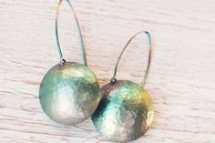 Large greenish round titanium hammered earrings from Arpelc Blue Titanium Jewelry by DaWanda.com