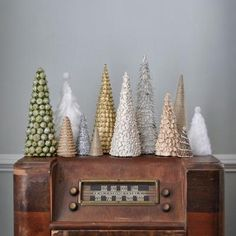 Handmade Christmas Trees {Christmas DIY} @Tip Junkie: This post features fun to make and super stylish to display handmade trees! Great not only because they are so beautiful but also because they were all made for under five bucks! Made easy with this great tutorial.