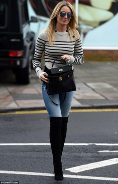 Lithe legs: Teaming her knitwear with a pair of distressed, skinnyfit jeans, Alex subtly showcased her lithe legs