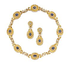 SAPPHIRE AND DIAMOND NECKLACE, AND PAIR OF MATCHING EAR CLIPS, FEDERICO BUCCELLATI.  The articulated necklace of floral design featuring eight cabochon sapphires, decorated by brilliant-cut diamonds, length approximately 410mm; and pair of matching ear clips, clip fittings; the sapphires altogether weighing approximately 10.50 carats, mounted in 18 karat yellow and white gold, signed.