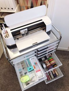 Organizing My Craft Closet With Cricut. Organizing My Craft Closet With Cricut - Lela Burris. How to organize a craft closet with a Cricut Maker, plus storage solutions for Cricut machines. Craft storage is dressed up with vinyl labels and wallpaper. Craft Room Storage, Craft Organization, Scrapbook Room Organization, Small Office Organization, Scrapbook Rooms, Classroom Storage Ideas, Office Storage Ideas, Diy Vinyl Storage, Office Ideas For Work