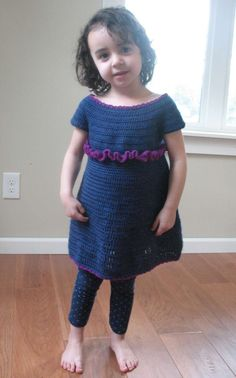 This free crochet pattern comes from Ball Hank n Skein. It's called the Easy Peasy Toddler Dress.