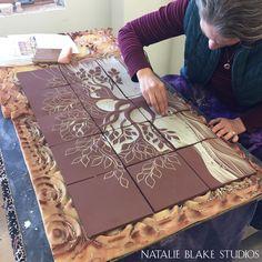 A new custom Tree of Life handmade ceramic tile backsplash being carved at Natalie Blake Studios, Brattleboro, Vermont