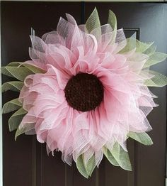 This soft pink sunflower with greenery is sure to be a conversation piece with all of your visitors. It is constructed of a poly jute material and the center is made of tiny pine cones to simulate the actual center of a real sunflower. If you love pink or are just wanting a sunflower with a twist, then this is the flower for you! It measures approximately 31 with the greenery and would also be a wonderful gift!  Here are some answers to some Frequently Asked Questions about the Sunflower…