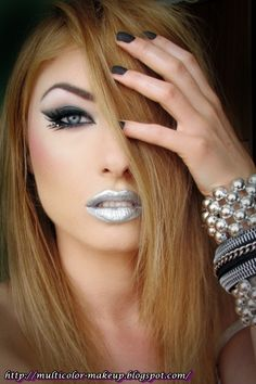 Silver lips and a pretty charcoal grey smokey eye with winged liner and crystal accents, titled 'Cold Silver'.