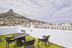 This light, bright & sunny apartment offers 3 bedrooms and 2 bathrooms. An added bonus is the stunning, exclusive roof deck from where you can enjoy lovely sea and mountain views. This apartment is a stone's throw from the shops, gym & beach and comes complete with lock-up garage. The complex features a pool and 24 hour manned security. Lions Head Cape Town, Balcony Ideas, Roof Deck, Mountain View, Outdoor Furniture, Outdoor Decor, Sun Lounger, Property For Sale, Bathrooms