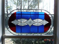Blue and red with bevel cluster stained glass