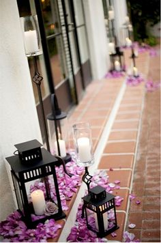 Coupled with candles, scattered purple petals lend such effortless beauty to this @Four Seasons Resort The Biltmore Santa Barbara wedding.
