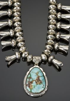 Sterling silver squash blossom necklace set with Royston turquoise by Mary Marie Lincoln.
