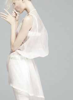 "mkrmagazine:  ""Total White"". Vika Falileeva  by Emilio Tini  for Flair May 2011    www.mkrmagazine.tumblr.com"