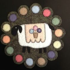 Wool felt penny rug. Like colored circles - use as card sketch idea?