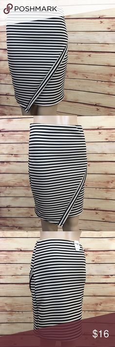 """Cream and black striped pencil skirt size M (nwt) Brand: Charlotte Russe Size: Medium Type: cream and black striped pencil skirt  Details: asymmetrical flap on front Waist measurement: 26"""" Length: 19"""" Condition: brand new with tags  Other: this item does not fit me, sorry I cannot model ✨Bundle discounts offered, just ask Charlotte Russe Skirts Pencil"""