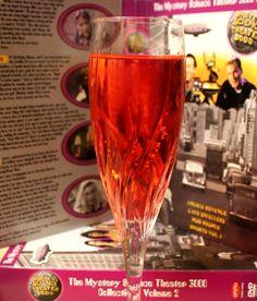 MST3K Cocktail: Angels' Revenge  3 parts proseco 1 part Grand Marnier 1 part peach schnapps 1/4 part of grenadine Pour into champagne flute, give a quick stir