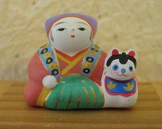 "Emperor with inu hariko clay figurine. 1 1/2""."