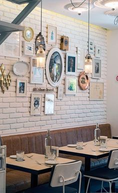 eclectic gallery wall on painted brick