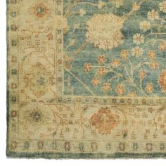 Spring Blossom Oushak Rug #WilliamsSonoma I like the pop of soft blue, golden border tones, green background and red/brick accents.