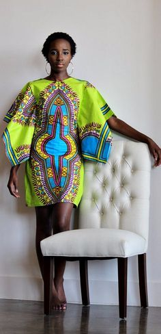 Top made from Holland Dashiki Print Fabric. African clothing, African Ankara Dashiki Dress; African Orange Dress, African fashion; African Print; African JackeT, African Ankara Jacket. Ankara | Dutch wax | Kente | Kitenge | Dashiki | African print dress | African fashion | Ankara maxi skirt | African prints | Nigerian style | Ghanaian fashion | Senegal fashion | Kenya fashion | Nigerian fashion | Ankara styles | Ankara dress (affiliate)