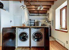Îlot central sur mesure dans la cuisine pour dissimuler la machine à laver et le sèche linge