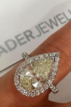 18 Stunning Pear Shaped Engagement Rings ❤️ pear shaped engagement rings yellow center diamond halo white gold ❤️ More on the blog: https://ohsoperfectproposal.com/pear-shaped-engagement-rings/