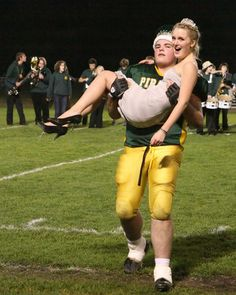 The football player carrying the homecoming queen - a classic and probably a funny moment, too.   A great sample image for a homecoming spread.  Want a quote for your yearbook?  Check out http://www.expressly-yours.com/