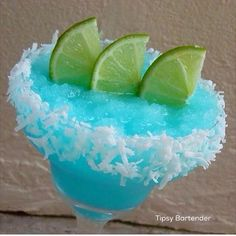 BLUE COCONUT MARGARITA  Rim glass and fill with crushed ice. 1 oz. (30 ml) Coconut Tequila  1 oz. (30 ml) Blue Curacao  1/2 oz. (15 ml) Malibu 1/2 oz. (15 ml) Lime Juice  3/4 oz. (22 ml) Coconut Cream  Shake and strain with ice into prepared glass. Garnish: Coconut Flakes Rim and Lime slices