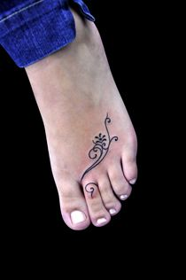simple and pretty foot tattoo