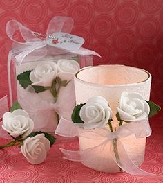 White Rose Candle Favors (FashionCraft 6105)   Buy at Wedding Favors Unlimited (http://www.weddingfavorsunlimited.com/white_rose_wrapped_candle_favors.html).