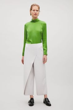 COS image 1 of High-neck silk blouse in Leaf Green