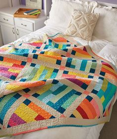Use a collection of warm and cool prints to create contrast between the blocks in this throw-size quilt pattern called Belle Prairie. The blocks are set on point with solid sashing, cornerstones, and borders to separate and define them. Use batik fabrics for an exciting finish! Scrappy binding completes the look.